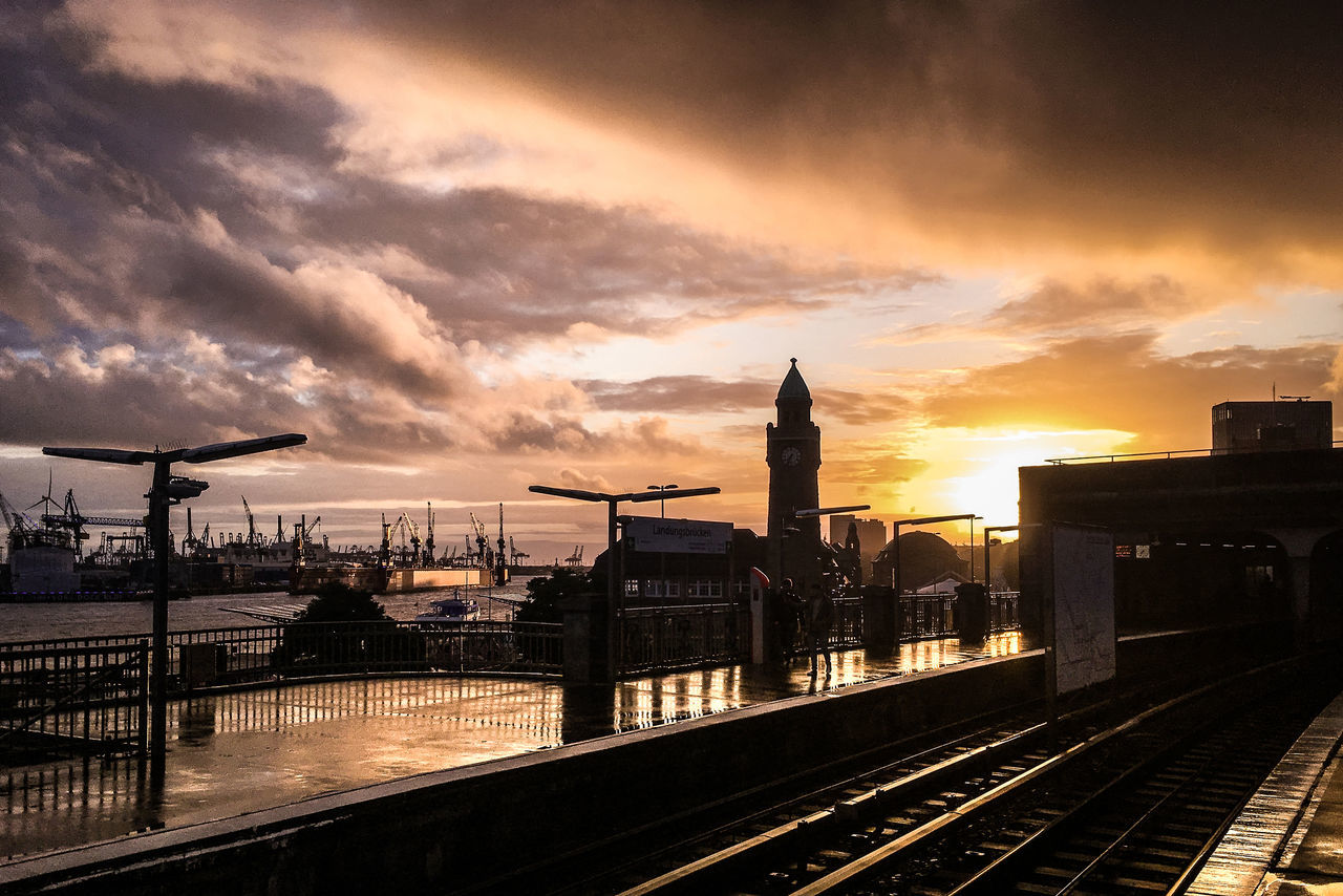 sunset, sky, transportation, built structure, cloud - sky, railroad track, rail transportation, silhouette, architecture, outdoors, no people, public transportation, building exterior, nature, city, beauty in nature, day
