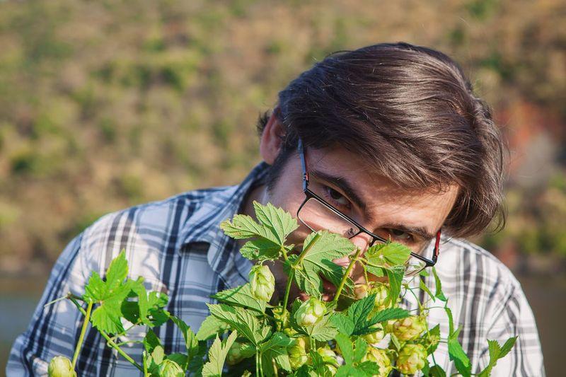 Close-Up Portrait Of Man Holding Plants