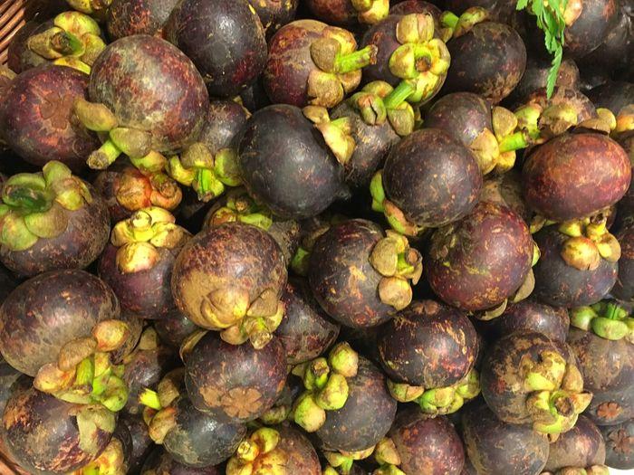 Full frame shot of mangosteens for sale at market stall