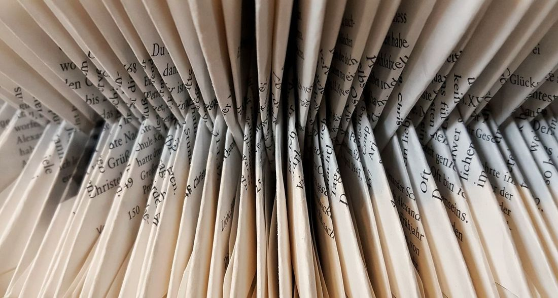 AntiM Letters Backgrounds Beige Tones Black Letters Book Folding Close-up Day Full Frame Indoors  Large Group Of Objects Letters Art No People Pages Book Pages Of A Book Paper