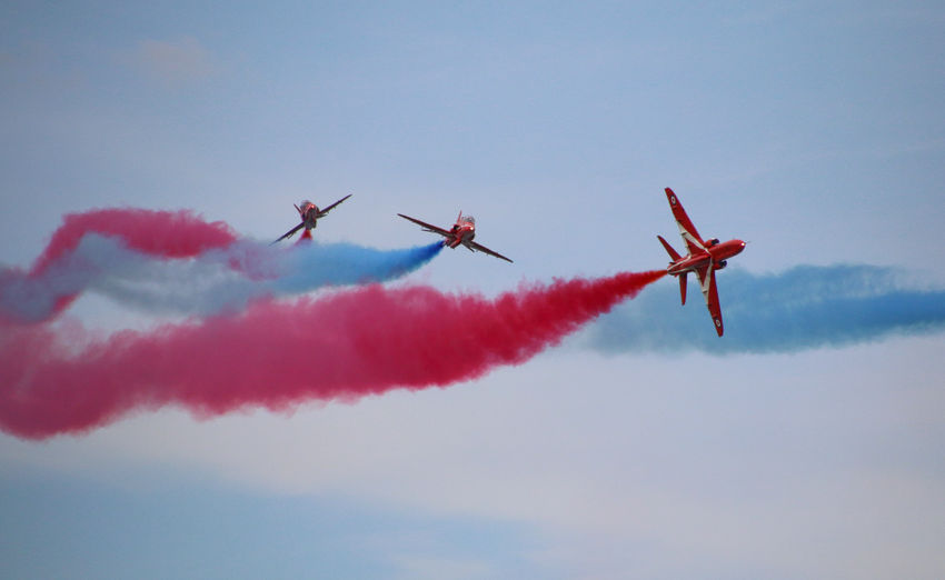 Low Angle View Of Red Arrows Performing At Airshow