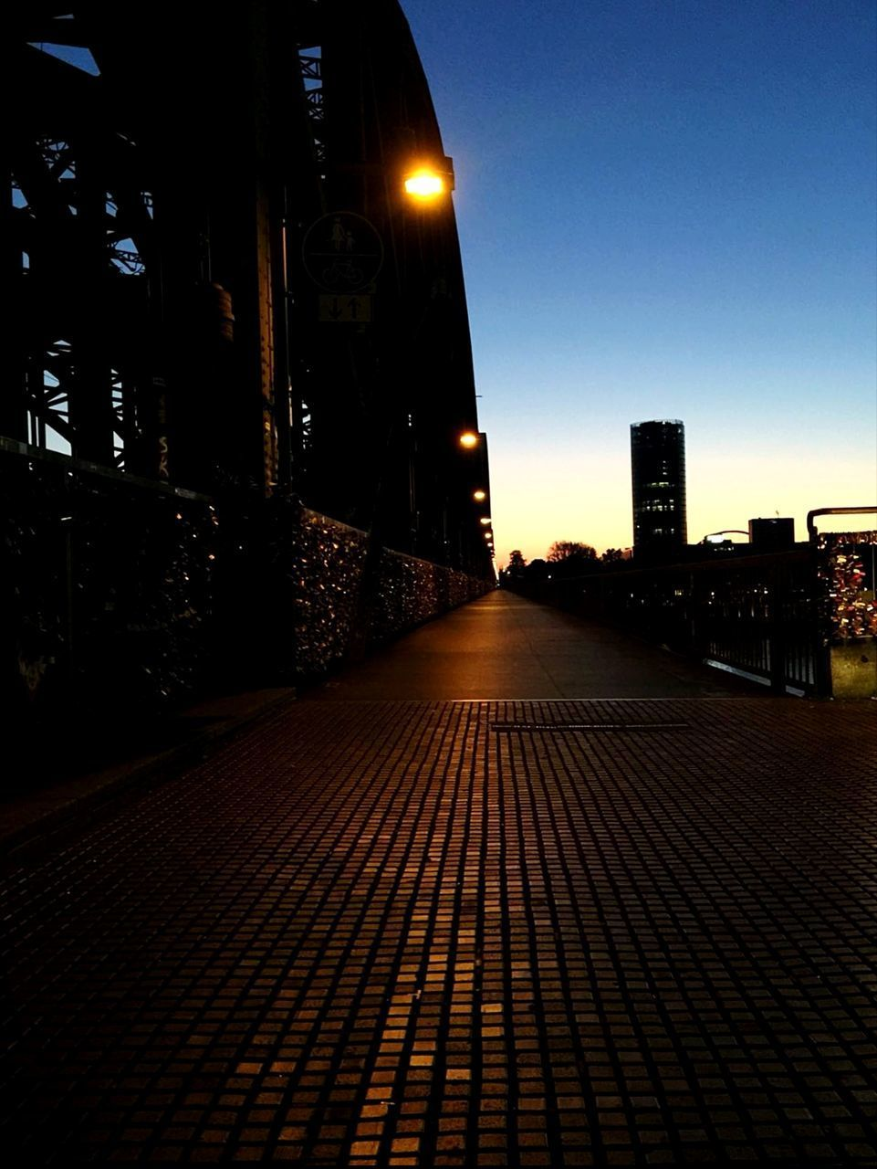 architecture, building exterior, city, built structure, street, illuminated, night, sky, building, cobblestone, no people, footpath, nature, direction, the way forward, street light, outdoors, lighting equipment, city life, sunset, paving stone