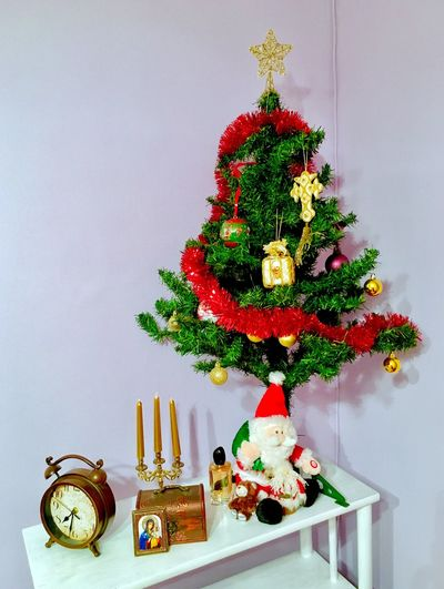 Decorated christmas tree on table at home