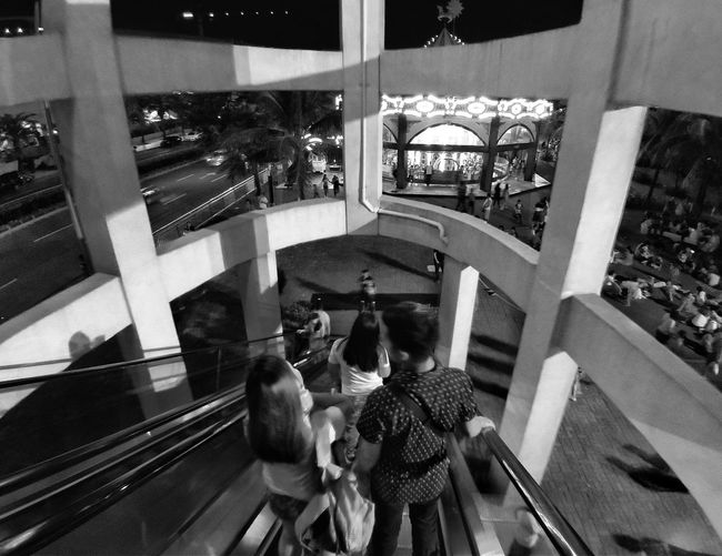 High angle view of people walking in glass building