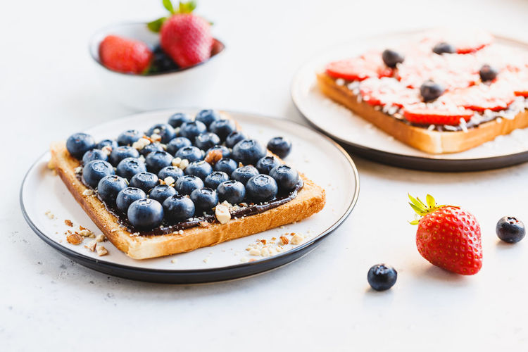 Toast Snack Sandwich Hucklberry Breakfast Close View Strawberry Bread Blueberry Berry Berries Chips Almond Coconut Vegetarian Photography Trend Modern Tasty Sweet Healthy Appetizer Butter Food Fresh American Marble White Cheese Gourmet Eating Cream Nut Diet Superfood Summer SLICE Two Bite Background Fruit Nuts Lunch Table Meal