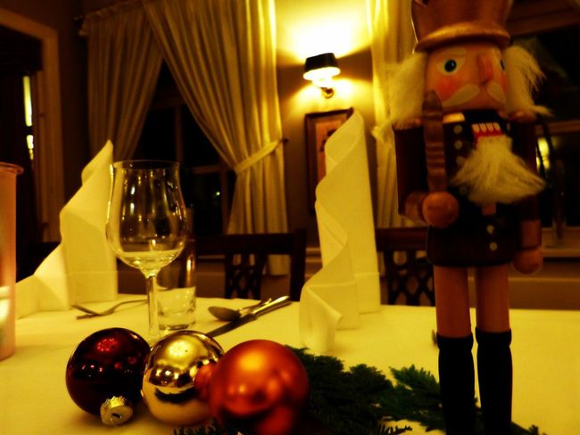 Restaurant Napkins Nutcracker Baubels Candle Celebration Christmas Decoration Christmastime Close-up Fir Food And Drink Illuminated Indoors  Laid Table Night Nutcrackersoldier Table Wine Wineglass
