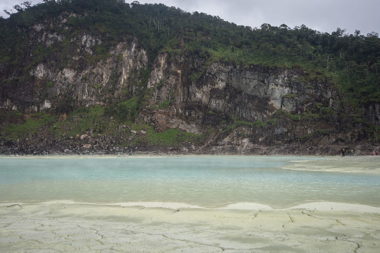 The Sulfur Lake at White crater or Kawah Putih in Ciwidey West Java, Near Bandung city, Indonesia Water Tranquility Beauty In Nature Land Nature Tranquil Scene Day No People Scenics - Nature Rock Mountain Environment Sea Solid Non-urban Scene Rock - Object Landscape Travel Outdoors Lagoon Pollution