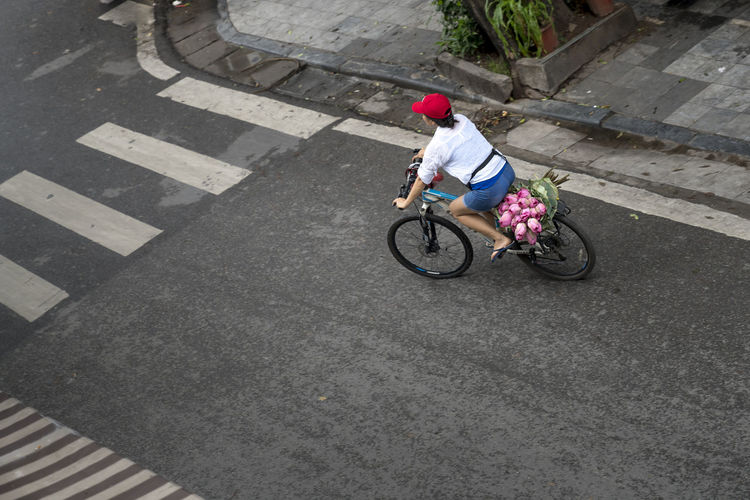 Woman with pink lotus bouquet in the morning in Hanoi Old Quarter, Vietnam. Beautiful Happy Morning Nature Vietnam Woman Backgrounds Bicycle Bouquet Clouse-up Cute Female Flowers Fresh Hanoi Hanoi Vietnam  Lotus Old Quarter Outdoor People Pink Color Pretty Style Summer Vintage
