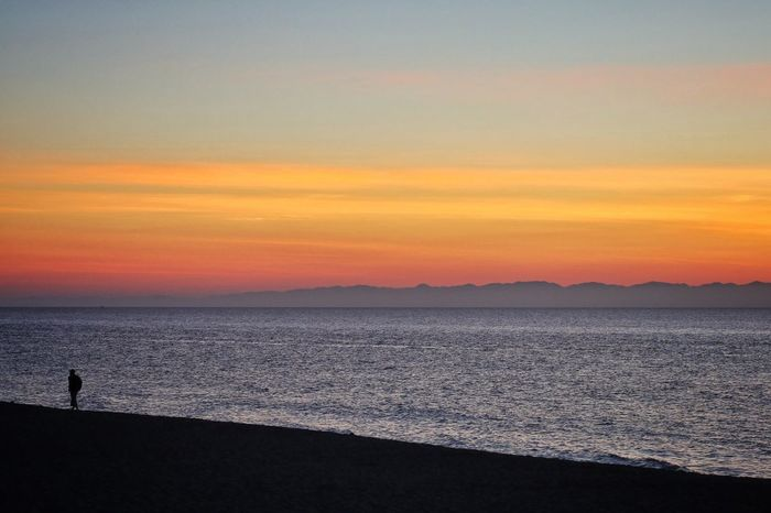 All alone 2/何処へ Sunset Scenics Beauty In Nature Tranquil Scene Nature Tranquility Sea Silhouette Idyllic Orange Color Water Beach Outdoors Sky Travel Destinations Mountain Horizon Over Water No People Day Canon EOS M5 in Niigata-shi Japan