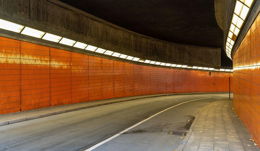 Transportation Road Architecture Illuminated Tunnel Subway Sign No People Indoors  Direction The Way Forward Empty Built Structure Road Marking Wall - Building Feature Symbol Marking Lighting Equipment Diminishing Perspective Ceiling Underpass Underground Walkway Long Dividing Line Orange Color