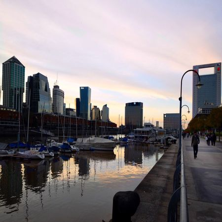 Sunset in Puerto Madero, Buenos Aires Architecture Building Exterior City Built Structure Skyscraper Urban Skyline Sky Transportation Water Sunset Building Story Tall - High Street Light Cloud Incidental People Modern Dark Light Shadow Cloudy Buenosaires Reflection Waterfront City Life Tower