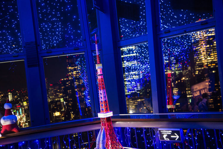 A model of the Tokyo Tower Tokyo Tokyo Tower Architecture Blue Building Exterior Built Structure City Cityscape Illuminated Model Modern Night No People Outdoors Skyscraper Window