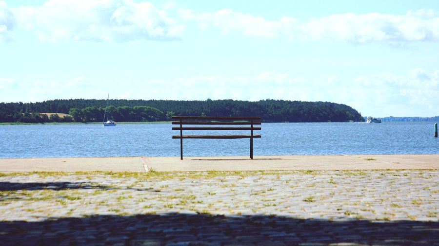 Sea Day Tranquility Nature Outdoors No People Blue Sky Water Beauty In Nature Sunlight Pier Bench Landscape Retro Styled Sailboat Leisure Sailing Vessel Summer Nautical Theme Harbor Tranquility Relaxing Moments Waterfront Sailing