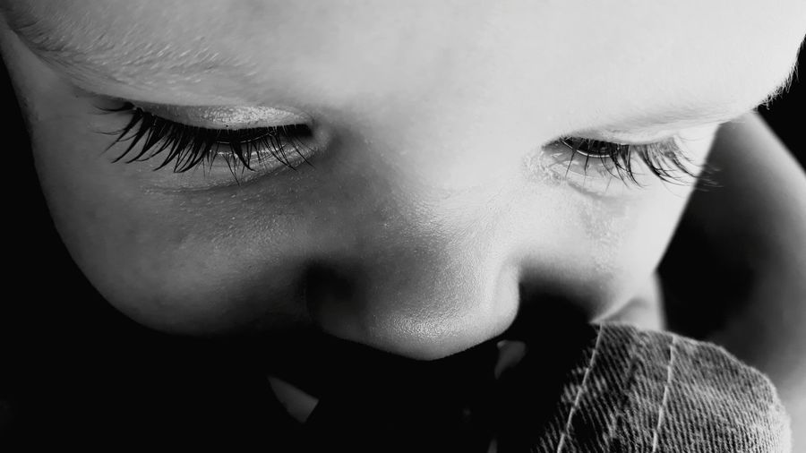 Close-up of baby boy crying while looking down