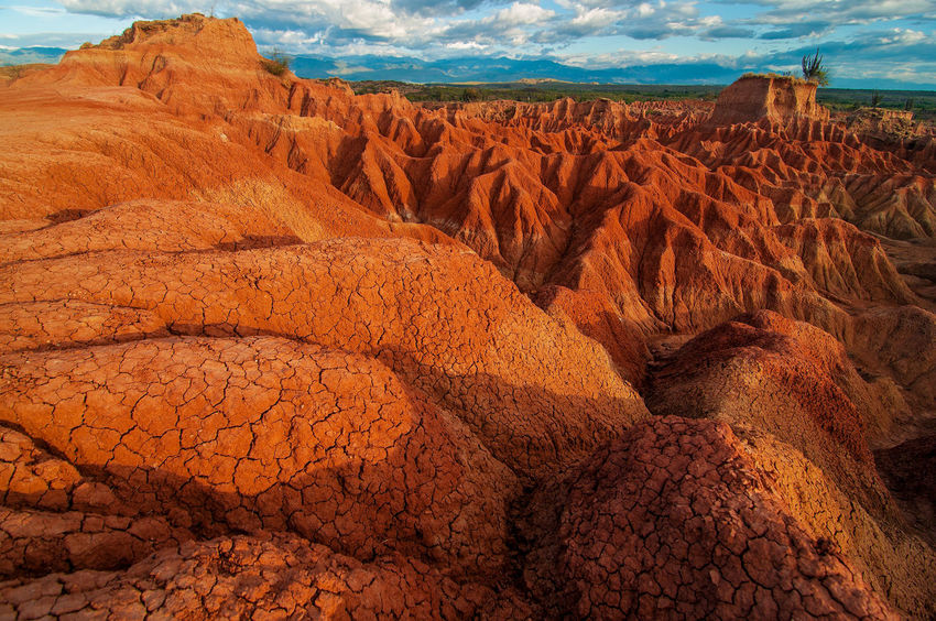 The red rock formations in Tatacoa Desert in Huila, Colombia Arid Blue Clouds Colombia Desert Drought Dry Heat Hot Huila  Landscape Nature Pillar Red Rock Sand Scenery Sky Stone Tatacoa Tourism Travel Valley View Wilderness