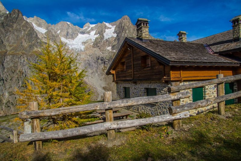 refuge bonatti,courmayeur,italy Architecture Built Structure Building Exterior Mountain Building Sky Tree Wood - Material Nature House No People Plant Day Cloud - Sky Scenics - Nature Residential District Beauty In Nature Landscape Mountain Range Outdoors