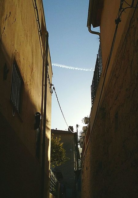 Light Of The City Smartphone Photography Street Photography Light And Shadow Low Angle View Dedo Rich Outdoors Clear Sky Vapor