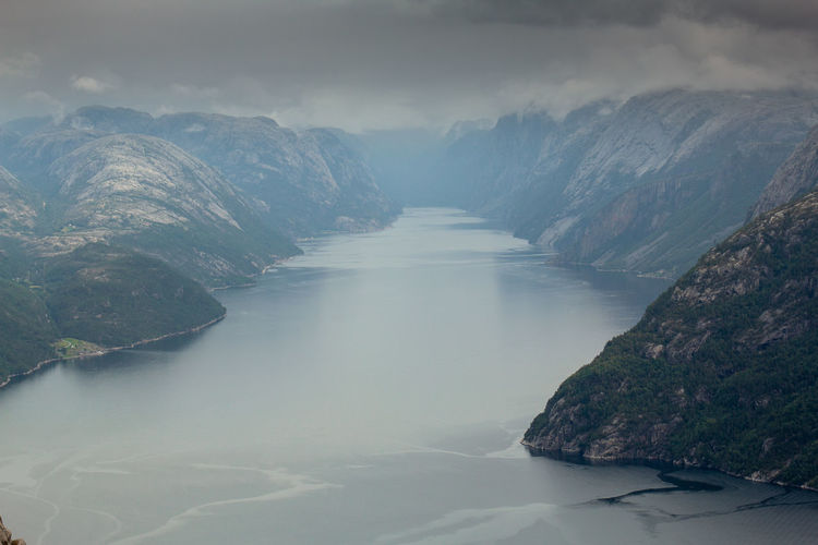looking into deep and narrow norway fjords Autumn Fjordsofnorway Holiday Travel Amazing Beauty In Nature Cloud - Sky Day Fjord Foggy Idyllic Mountain Nature No People Non-urban Scene Outdoors Rock Rock - Object Scenics - Nature Sea Sky Tranquil Scene Tranquility Water Waterfront