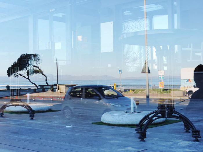 Reflections Glass Restaurant Porch Street Scene Cars Passing People Jogging Sea