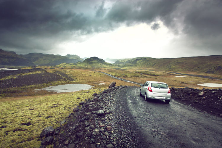Beauty In Nature Car Cloud - Sky Day Driving Driving Iceland Land Vehicle Landscape Mode Of Transport Nature No People Outdoors Rural Scene Scenics Sky Transportation Travel