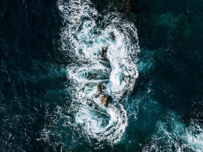 Abstract aerial of waves hitting a stack of rocks on Madeira, Portugal DJI X Eyeem Madeira Portugal Rock The Week on EyeEm Aerial Beauty In Nature Day Motion Nature No People Outdoors Sea Water Waterfront Shades Of Winter An Eye For Travel The Great Outdoors - 2018 EyeEm Awards