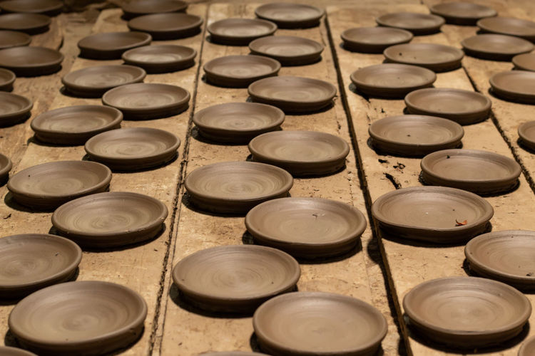 High angle view of clay plates on table