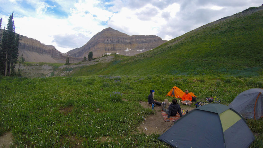 Stormy night coming our way, good thing the hike was beautiful. Adventure Backpacking Beauty In Nature Camping Cloud - Sky Day Grass Green Color Growth Landscape Lifestyles Live For The Story Meadow Men Mountain Nature Outdoors People Real People Scenics Sky Tent Tree Utah Woman