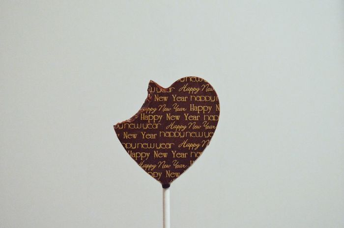 Chocolate Lolipop Minimal Minimalobsession Simplicity EyeEm Selects Heart Shape Love Valentine's Day - Holiday Shape Food And Drink Candy Heart Studio Shot Indoors  Sweet Food Candy White Background Close-up Food Food Stories Visual Creativity The Still Life Photographer - 2018 EyeEm Awards