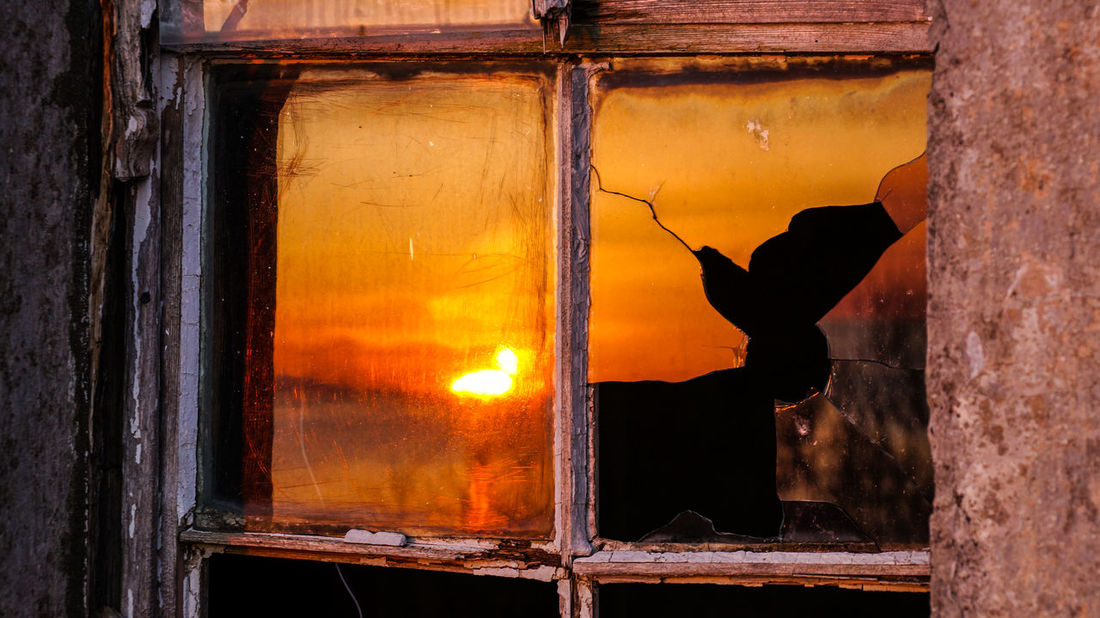 A shattered glass reflecting the sunset in Scotland. Sunset_collection Animal Themes Architecture Close-up Day Glass Indoors  Mammal Nature No People Shattered Shattered Glass Sunset Sunset #sun #clouds #skylovers #sky #nature #beautifulinnature #naturalbeauty #photography #landscape Sunsset Window Windows