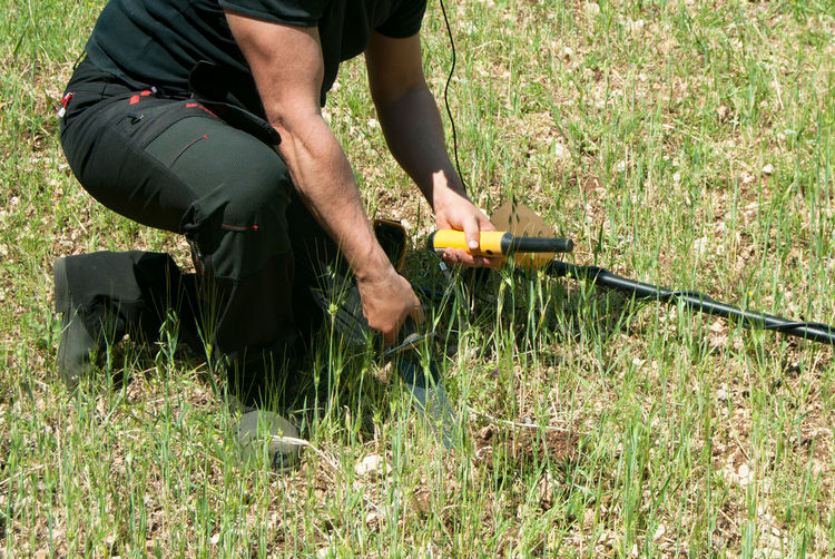 Low section of man working on field