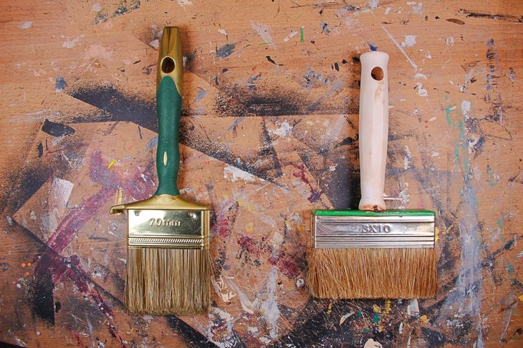 Directly Above Shot Of Paintbrushes On Messy Table
