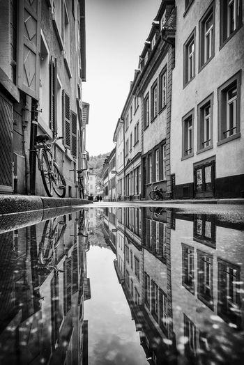 Heidelberger Altstadt nach einem Regenschauer Black And White Bycicle Fahrrad Altstadt Heidelberg City Day Nature Sky No People Window Symmetry Outdoors Standing Water