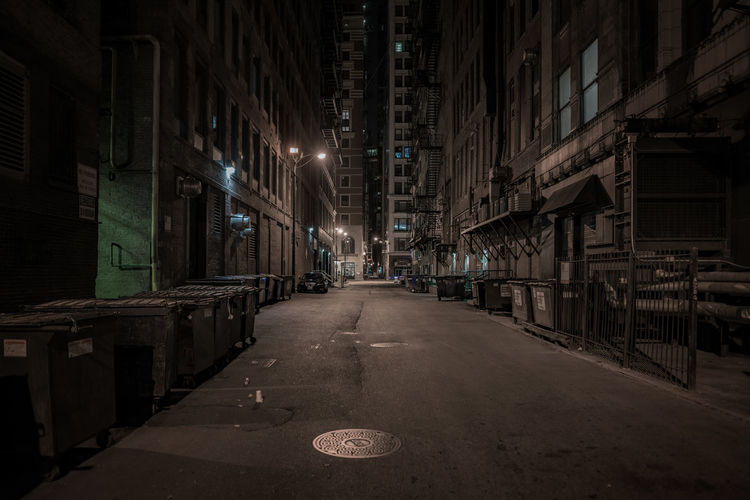 Empty Street Amidst Buildings At Night