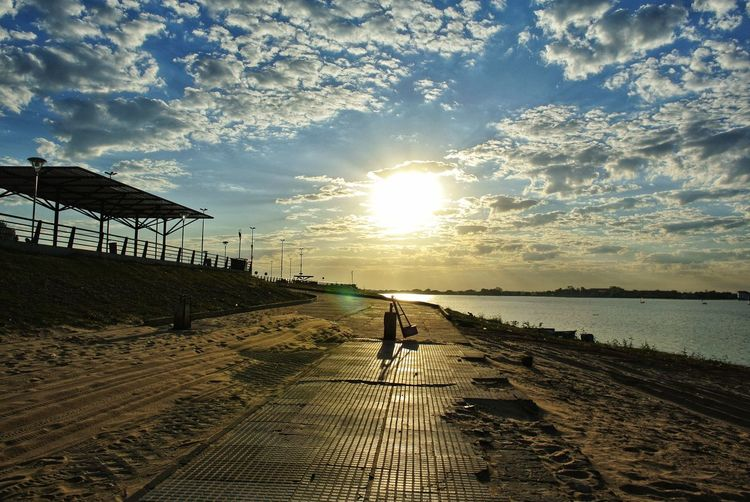 Sunset. Paraguay. Local Promenade Clouds And Sky Cloud Cumulus Cloud Sunset_collection EyeEm Sunset Nature Photography Nature_collection Cityscape Southamerica Capital Cities  Travel Río Paraguay Paraguay Asunción Costanera  Costanera De Asunción Riverfront River Water Sea Beach Sand Sunset Sky Horizon Over Water Cloud - Sky FootPrint Sandy Beach
