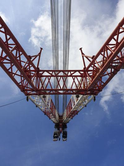 Low angle view of crane bridge against sky