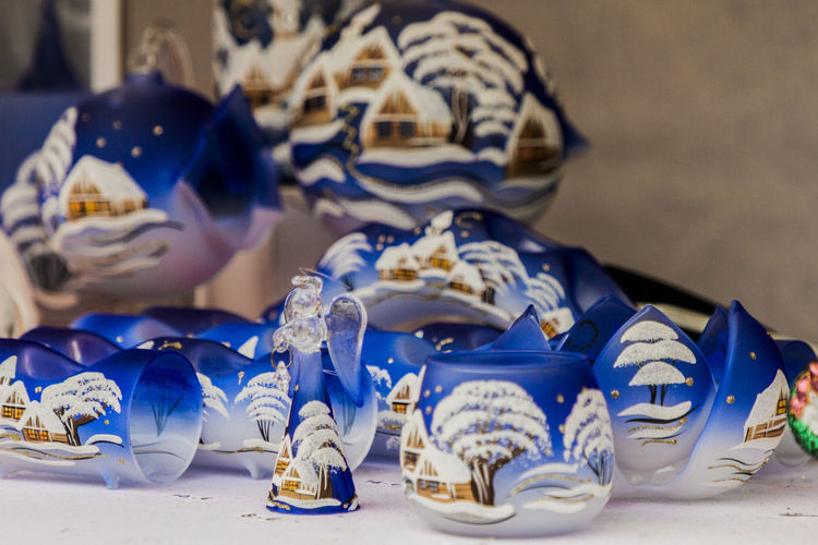 a few photos from the Košice Christmas market Blue Table No People Still Life Indoors  Shoe Close-up Focus On Foreground Representation Creativity Celebration Art And Craft Selective Focus White Color Food And Drink Large Group Of Objects Variation Mask - Disguise Human Representation