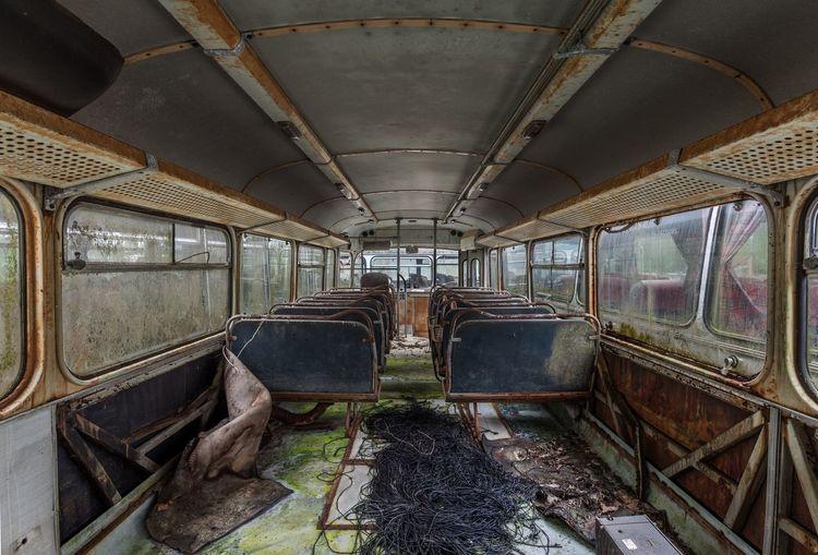 La meilleure place est au fond Perspective Lines Transportation Rail Transportation Vehicle Interior Train Train - Vehicle No People Public Transportation Metal Indoors  Obsolete Abandoned Travel Damaged