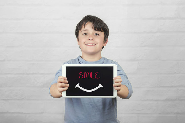Smiling Portrait Child Happiness Text Screen Tablet Digital Computer Communication Student Happy Internet Concept Drawing Technology Cyber Space Draw Fun Funny Education Idea Emotion Lifestyle Smile