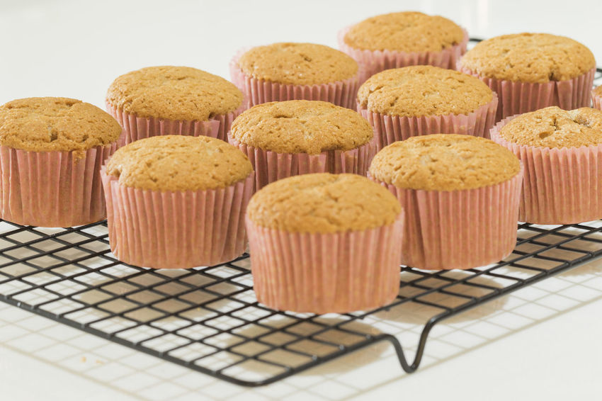 newly made cinnamon cupcakes in a cooling rack Cupcakes Homemade Baked Close-up Cupcake Cynamon Day Dessert Food Food And Drink Freshness Indoors  Indulgence Muffin Muffins No People Ready-to-eat Sweet Sweet Food Temptation Variation