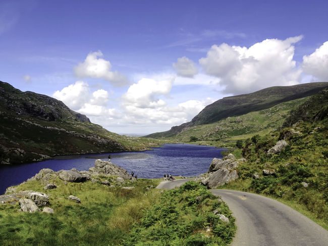 Memories of Ireland Beauty In Nature Cloud Cloud - Sky Idyllic Ireland Irelandinspires Landscape Mountain Mountain Range Nature Outdoors Road Sky The Way Forward Tranquil Scene Vacation Water Enjoy The New Normal