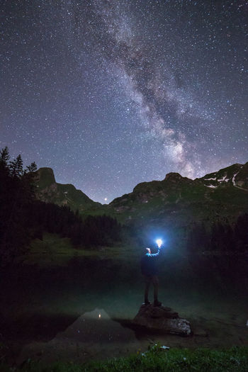 Gastrisch Hello Astronomy Beauty In Nature Flashlight Galaxy Gantrischseeli Illuminated Leisure Activity Letsgosomewhere Lifestyles Milky Way Nature Night One Person Real People Scenics - Nature Sky Space Standing Star Star - Space Star Field Switzerland Tranquility