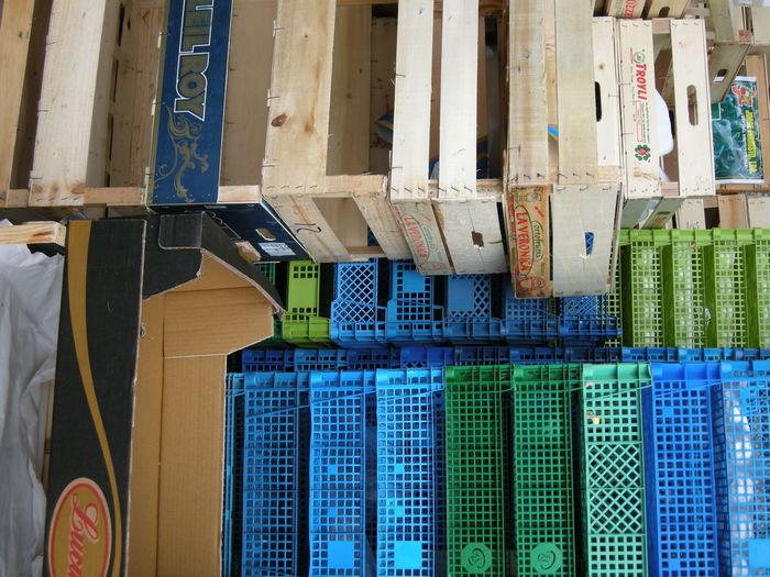 Stack of multi colored plastic crates