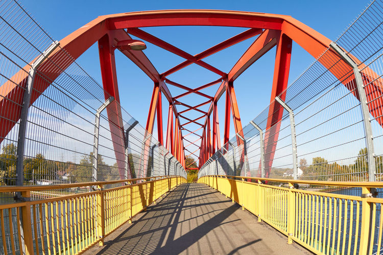 footbridge Footbridge Architecture Bridge Bridge - Man Made Structure Building Exterior Built Structure City Clear Sky Connection Day Diminishing Perspective Direction Engineering Footbridge Metal Nature Outdoors Railing Sky Sunlight Suspension Bridge The Way Forward Transportation Travel Destinations