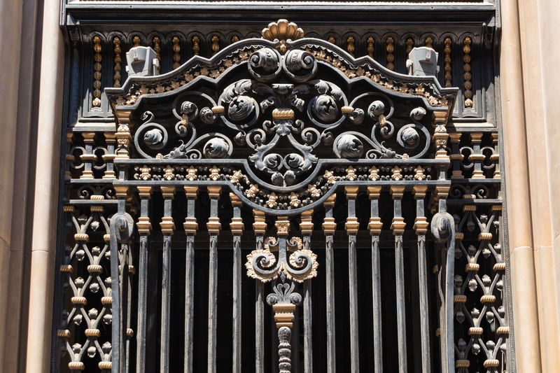 Bronze Architectural Feature Architecture Art And Craft Bas Relief Building Built Structure Carving - Craft Product Close-up Craft Creativity Day Design Door Entrance Gold Colored Gothic Style History Metal No People Ornate Pattern Travel Destinations Wrought Iron