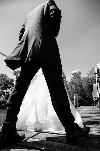Black And White Black Suit Blackandwhite Blackandwhite Photography Day Dramatic Angles Groom Low Section Outdoors Person Sky Standing Wedding