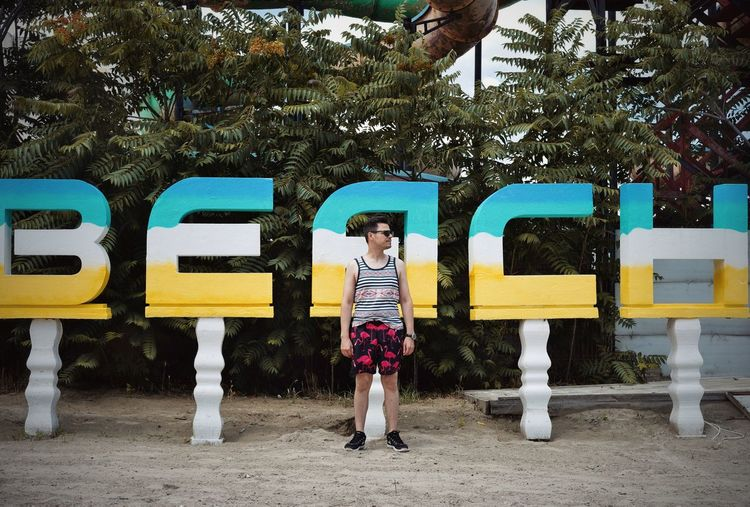 Text Beach One Person One Man Only Men People Tree Full Length Standing Communication Mid Adult Information Signboard Board Written Warning Information Sign Capital Letter Sign