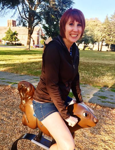 Ride The White Pony Looking At Camera Portrait Real People Smiling Casual Clothing Lifestyles Press For Progress Visual Creativity