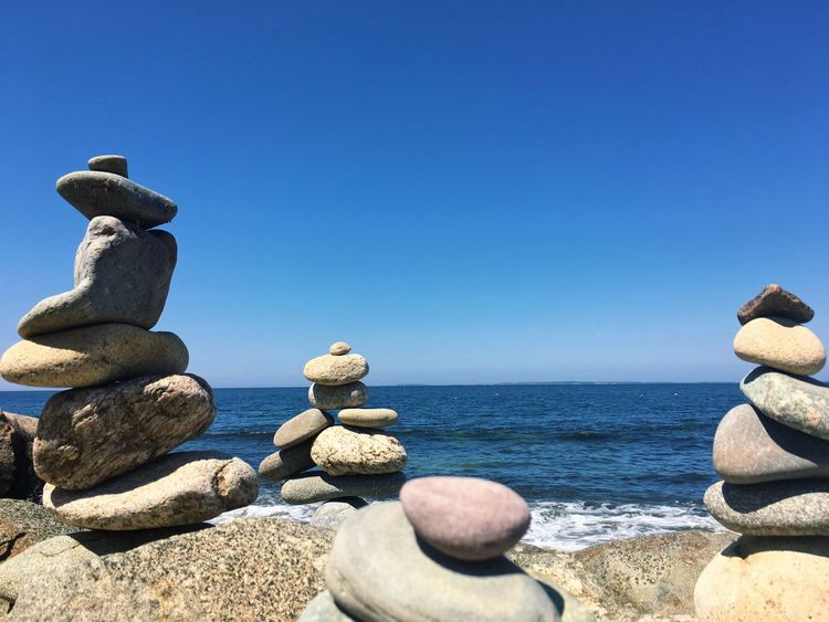 Rock Towers Sea Rock - Object Water Balance Copy Space Tranquil Scene Clear Sky Blue Nature Tranquility Rock Pyramid Day Scenics Pebble Outdoors Beauty In Nature No People Horizon Over Water Beach Sky The Week On Eyem