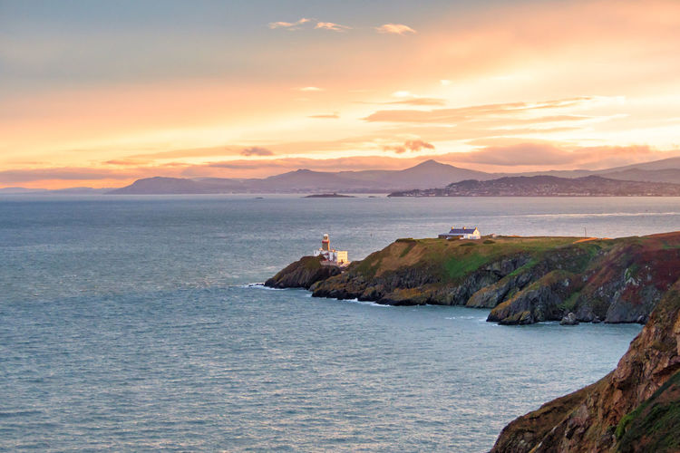 Dublin Howth Ireland Lighthouse Sunlight Travel Travel Photography Beauty In Nature Beauty In Nature Day Horizon Over Water Mountain Nature Nautical Vessel Outdoors Real People Scenics Sea Sky Sunset Sunset #sun #clouds #skylovers #sky #nature #beautifulinnature #naturalbeauty #photography #landscape Tranquility Travel Destinations Water
