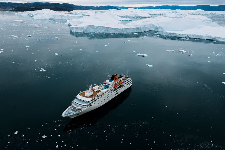 Water Sea Nautical Vessel Nature Transportation High Angle View Mode Of Transportation Cold Temperature Ship Day Outdoors Winter Aerial View Beauty In Nature Ice No People Scenics - Nature Snow Cruise Ship Iceberg Vessel